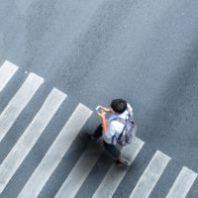 man crossing a crosswalk